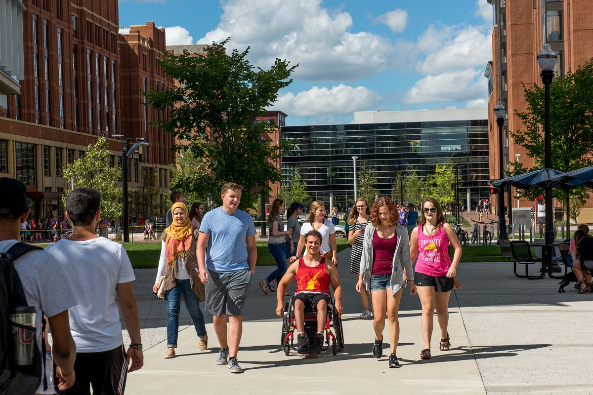 Students walking together in a group on campus